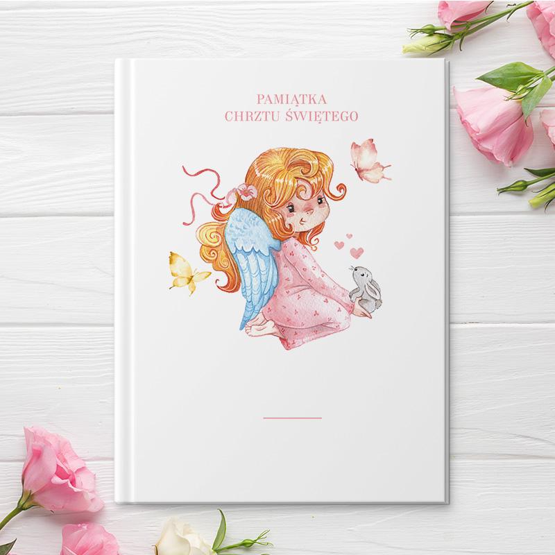 Okładka Biblii z postacią dziewczynki która ma skrzydła jak anioł.