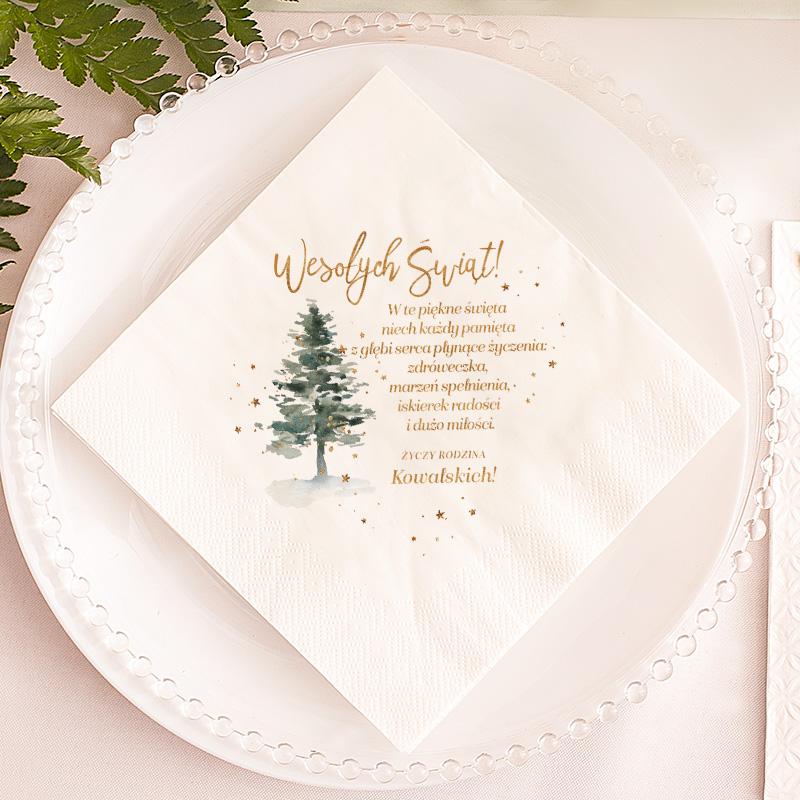 dekoracyjna serwetka stołowa z motywem leśnej choinki oraz życzeniami świątecznymi i podpisem