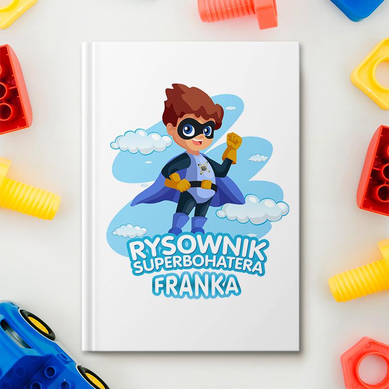 Zeszyt na rysunki dla chłopca z superbohaterem na okładce oraz imieniem