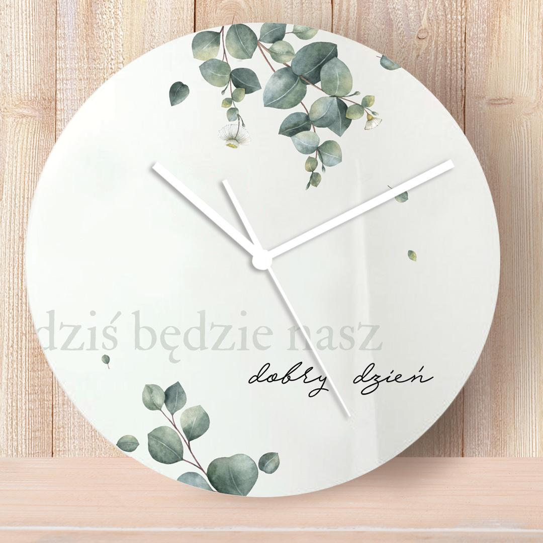 Zegar na ścianę z imionami pary oraz dedykacją i ozdobnym nadrukiem w postaci liści eukaliptusa