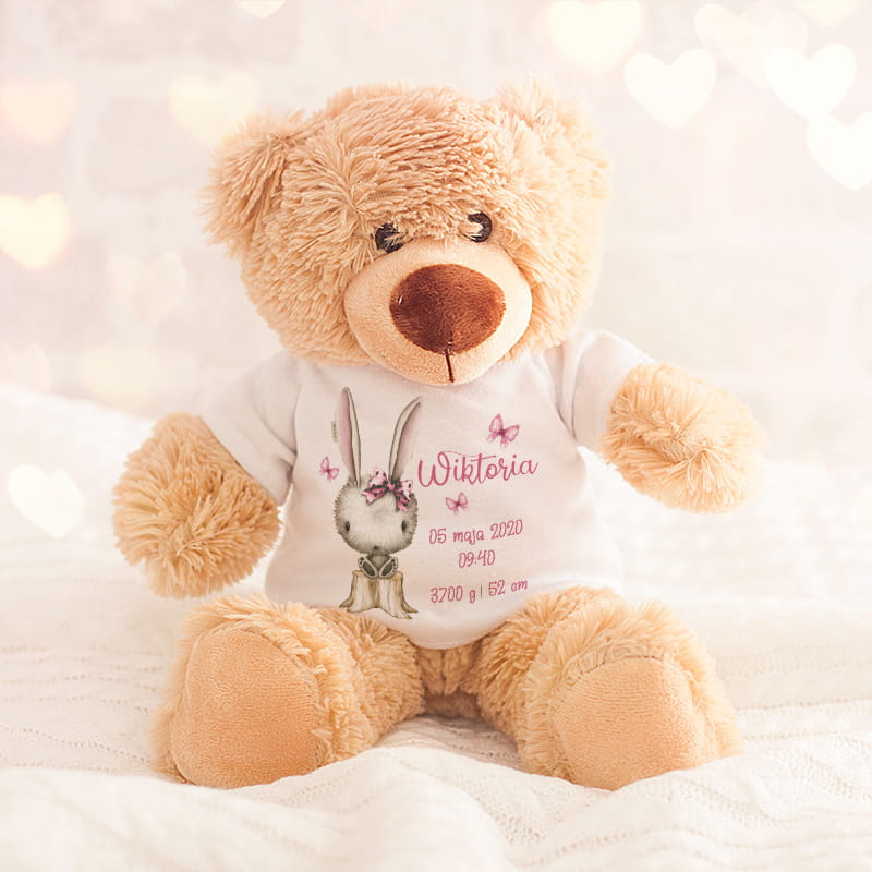 mięciutki, pluszowy miś w białej koszulce , z piękną grafiką króliczka oraz różowymi napisami - imieniem dziewczynki oraz metryczką