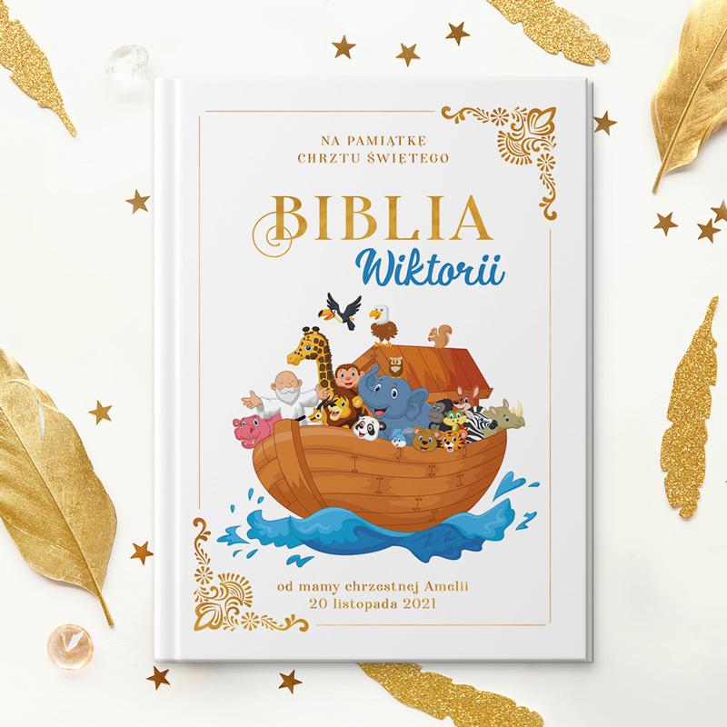 Biblia z personalizowaną okładką z grafiką Arki Noego, dedykacją z imieniem dziecka, datą oraz podpisem od kogo jest prezent.