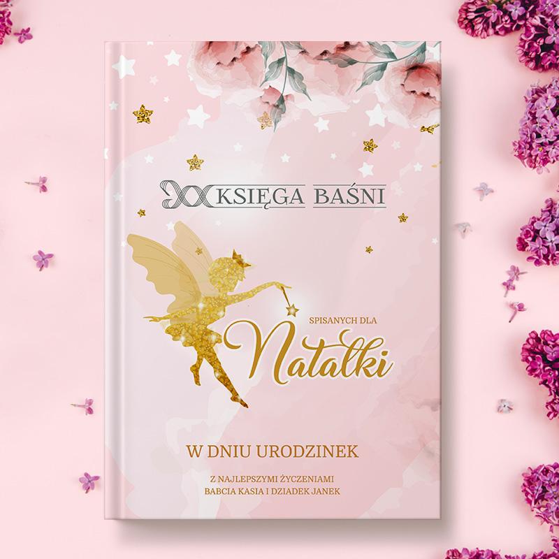 Książka z różową okładką ze złotą wróżką z różdżką oraz dedykacja na okładce, imieniem, i podpisem.