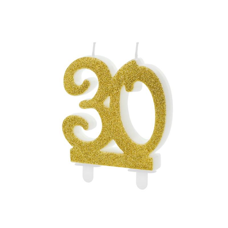 Świeczka urodzinowa w kształcie liczby 30, w złotym kolorze.