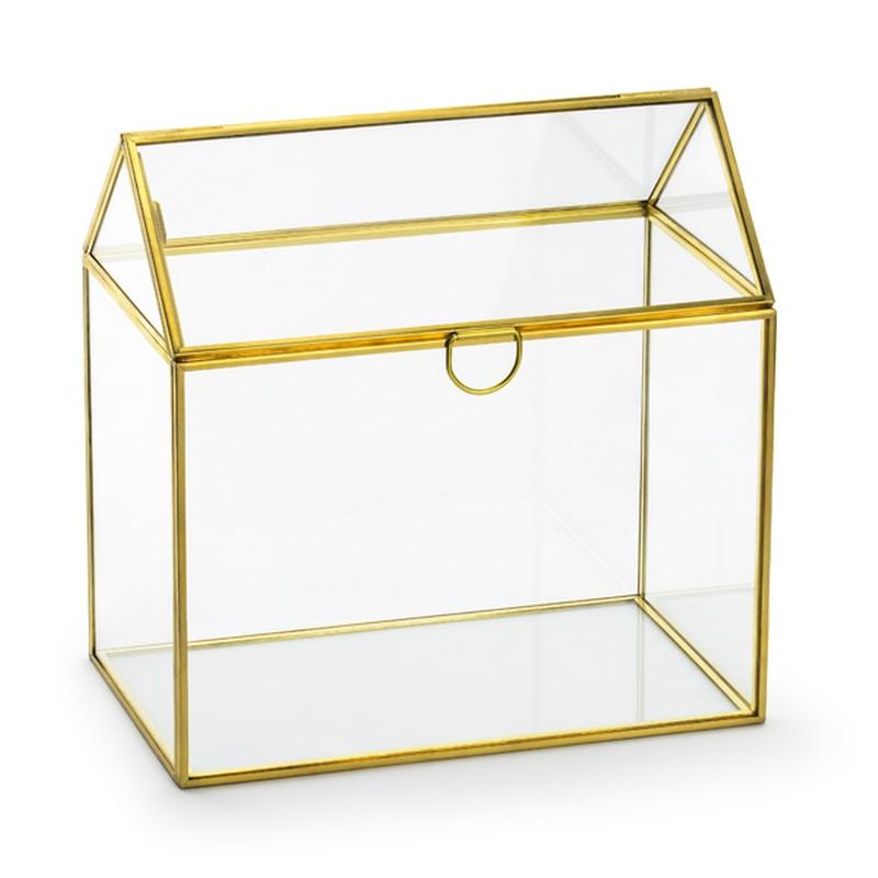 Szklany domek z otwieranym dachem i złotą obwolutą.