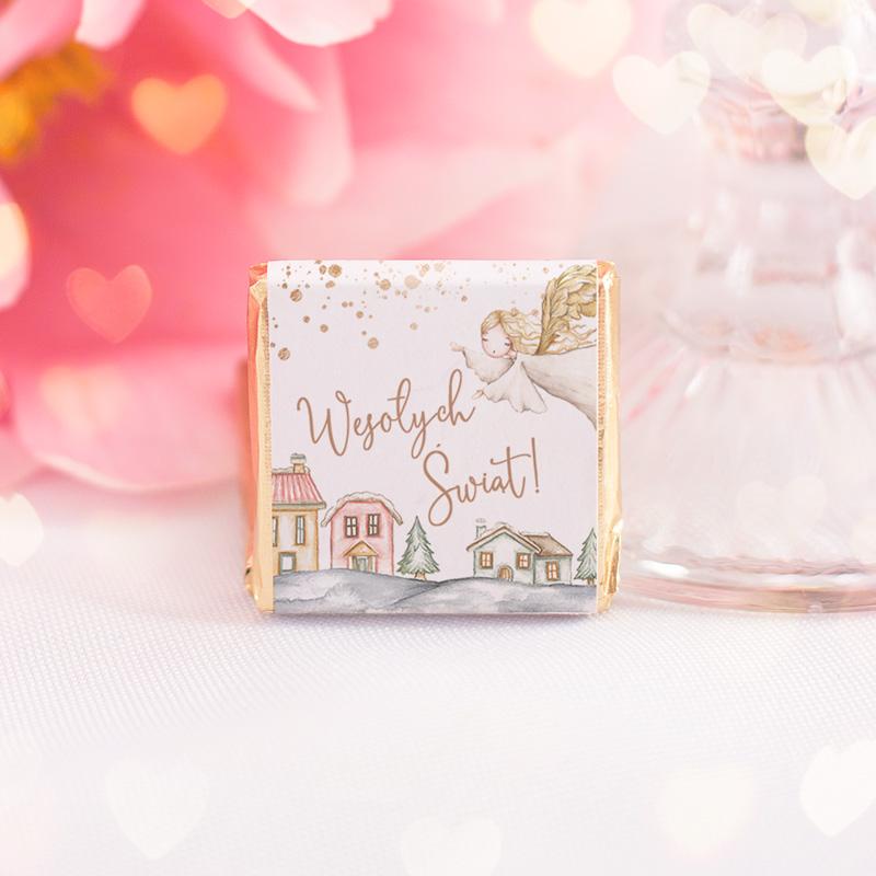 Mleczna czekoladka z uniwersalną etykietą świątecznego aniołka i napisem Wesołych Świąt.