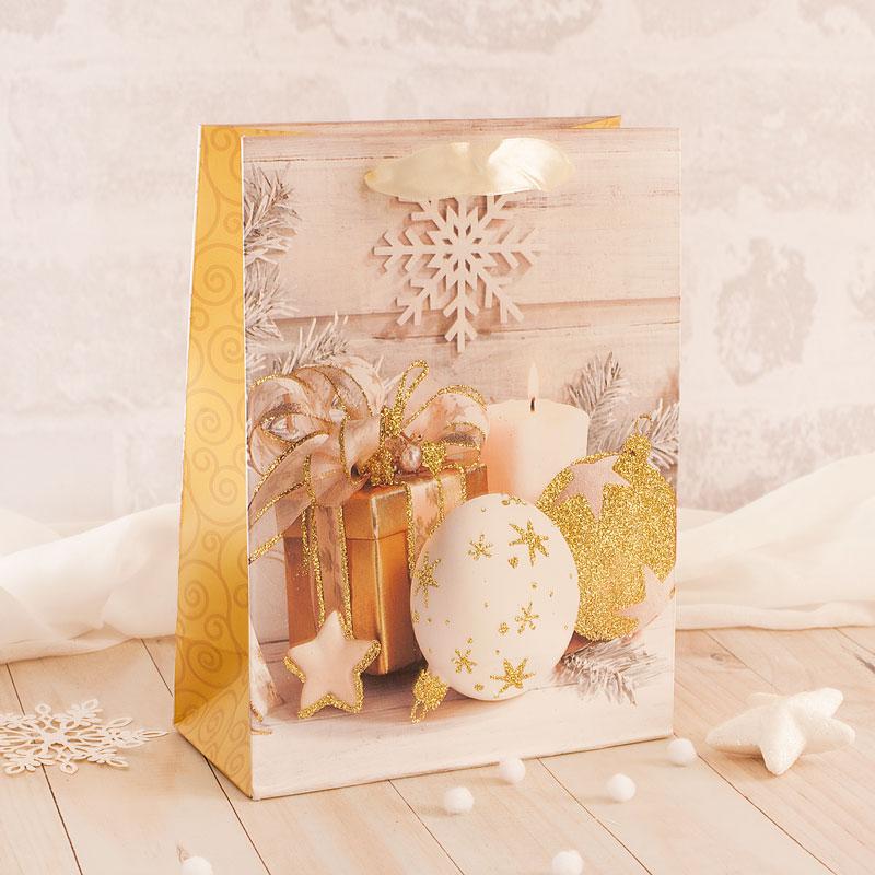 Torebka na prezenty złote święta z brokatowymi akcentami.