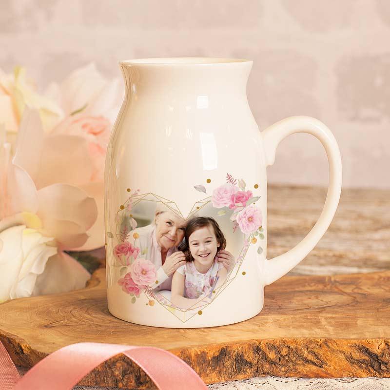 Kubek w kształcie bańki na mleko ze zdjęciem w sercu, na odwrocie znajduje się napis Najlepsza babcia + IMIĘ