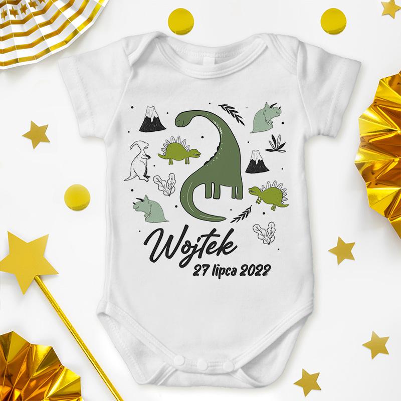 Body niemowlęce w białym kolorze posiada grafikę dinozaury oraz napis - mię oraz datę urodzin