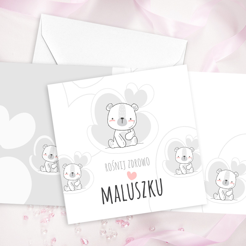 Kartka dla dziecka, do samodzielnego wypisania życzeń z okazji narodzin lub na roczek. Na kartce znajduje się biały miś, jest to kartka dla dziewczynki.