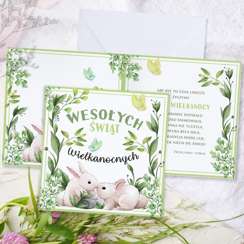 Personalizowana kartka wielkanocna z życzeniami i podpisem. Na kartce znajduje się bogate zdobienie z zajączkami pośród łąk i traw.