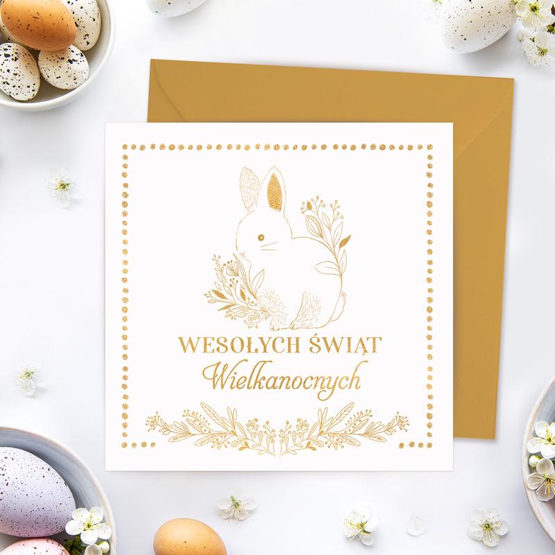 Elegancka kartka wielkanocna z życzeniami ze złotym zającem na okładce.