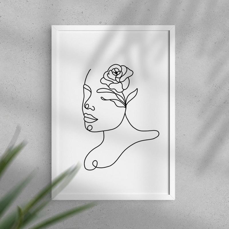 Dekoracyjny plakat na ścianę z motywem kobiecej twarzy z kwiatem we włosach. Wykonany czarną kreską, minimalistyczny.