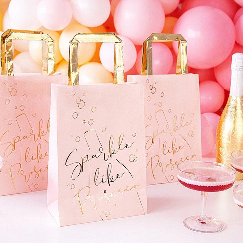 Torebki papierowe z rączką, różowe ze złotym napisem Sparkle like prosecco.