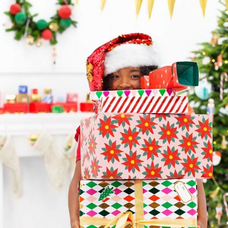 Papier dekoracyjny ze świątecznym motywem w postaci gwiazdy betlejemskiej.